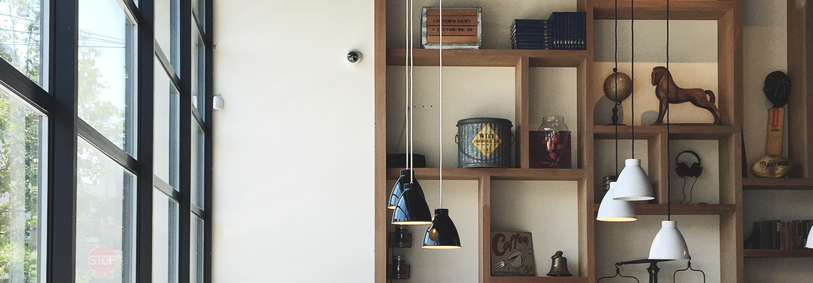 tobys estate coffee shop, williamsburg | curated shelving decor close up